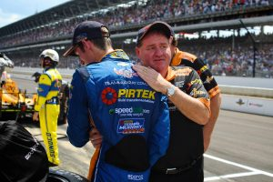 Emotional team owner, Brett Murray embraces Matt Brabham at the completion of the 100th running of the Indianapolis 500